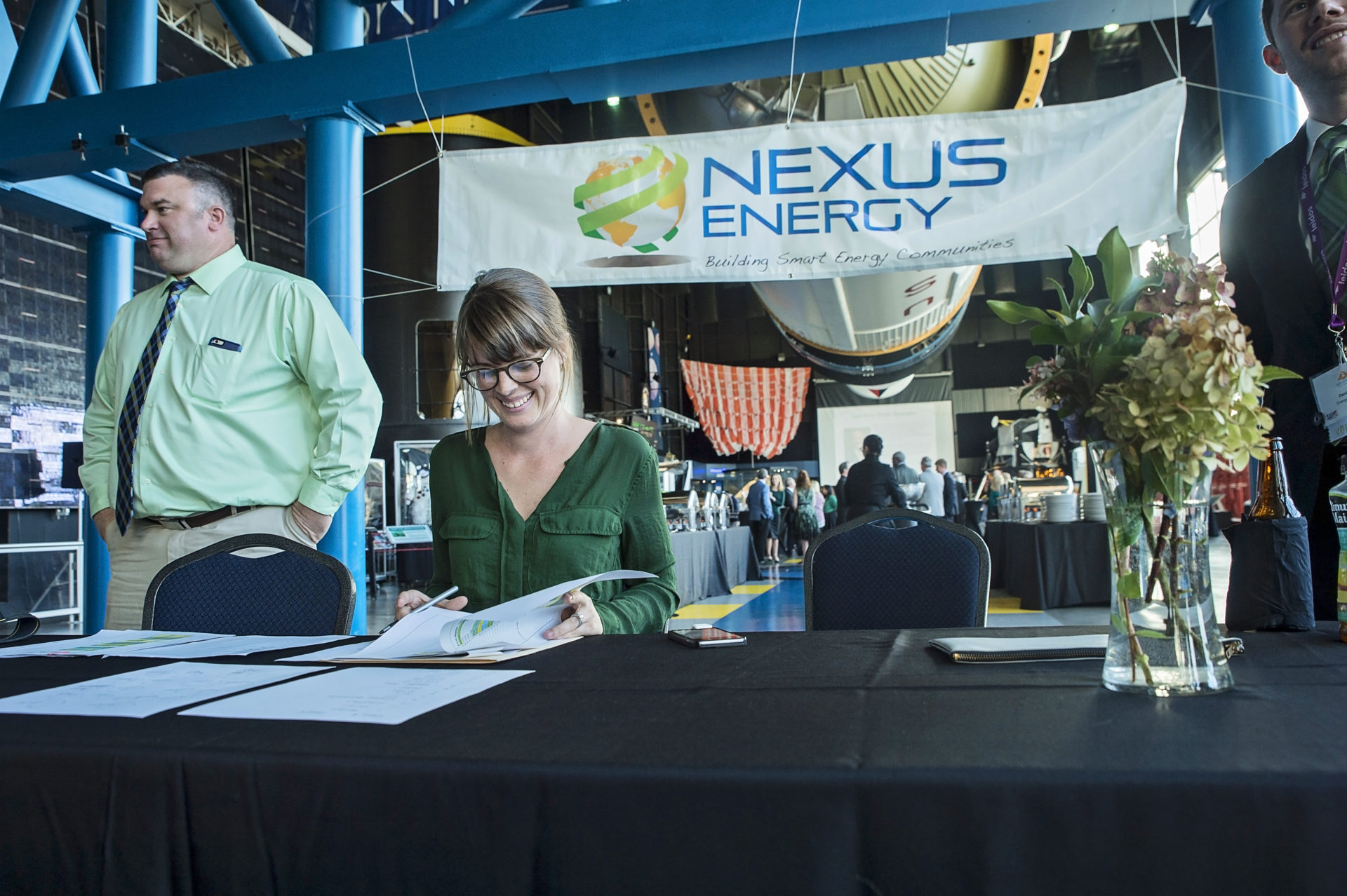 At the registration table with Joshlyne VIllano, Office Manager at Nexus Energy Center